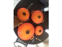 Lovely Le Creuset Volcanic Orange Cast Iron Pans with Lids