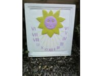 A sun dial painted in fun colours .
