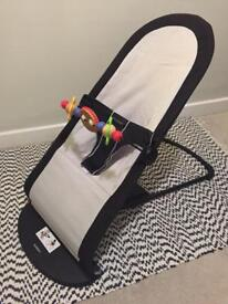 BabyBjorn bouncer and wooden toy