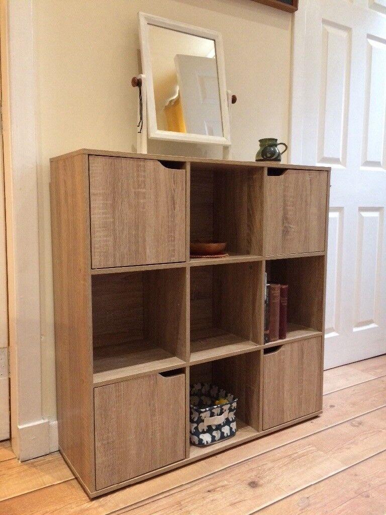 Shelf unit with cupboards