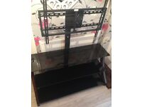 Very large black glass wooden leg tv stand