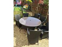 Garden dining table and chairs.