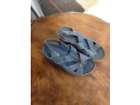 new and unworn ladies size 4 leather and leather lined blue sandals