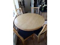 Round pine table with 4matching chairs with black seats