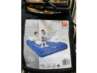 Double air bed and foot pump. Used once.