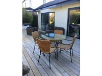 Glass dining table and 4 chairs (indoor use)