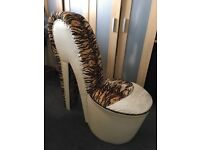Shoe shaped chair in fake tiger fur and cream pvc
