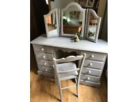 Dressing table, chair and mirror.