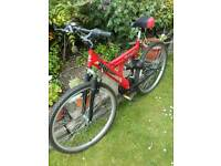 Red dual suspension mountain bike
