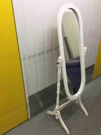 White vintage oval mirror on stand