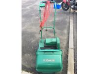 Qualcast electric self-propelled cylinder mower with scarifier attachment