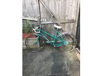 Ladies green vintage peugeot bicycle with drop handle bars