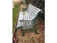 Cast iron green and wooden garden bench