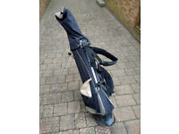 Ogre Golf Bag and Eight Golf Clubs Plus Accessories.