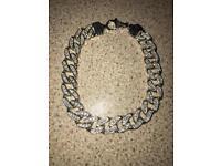 Sterling Silver & Cubic zirconia curb bracelet.