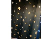 Blue eyelet curtains, black out