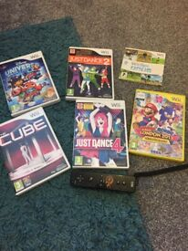 6 Nintendo wii games and a controller