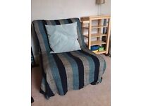 Single futon sofa bed on metal frame