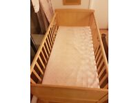 Pine Cot/Cot bed, as new, never slept in, unmarked. 3 Adjustable heights. No mattress