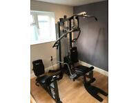 Multi gym with leg extension and leg press