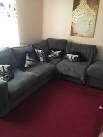 Grey corner sofa and foot stool
