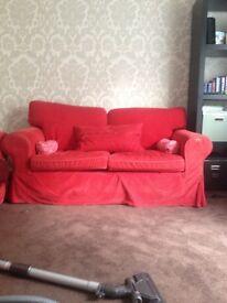 Red corduroy two seater sofas