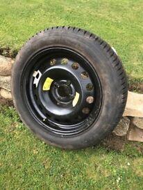 Brand new Michelin tyre on rim