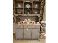 Kitchen dresser with storage and light oak stain finish on top
