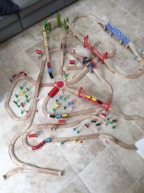 Wooden train set with trains and accessories