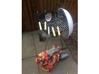 Kettle BBQ with Stand on Wheels with some utensils and some coals Barbeque has only been used twice