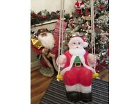 vintage light up santa on a swing quite rare