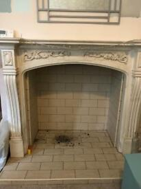 Marble-effect fireplace surround.