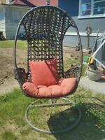 Hanging outdoor chair in frame