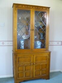 Oak Display Cabinet. From Larkswood of Aspley Guise. Good condition.