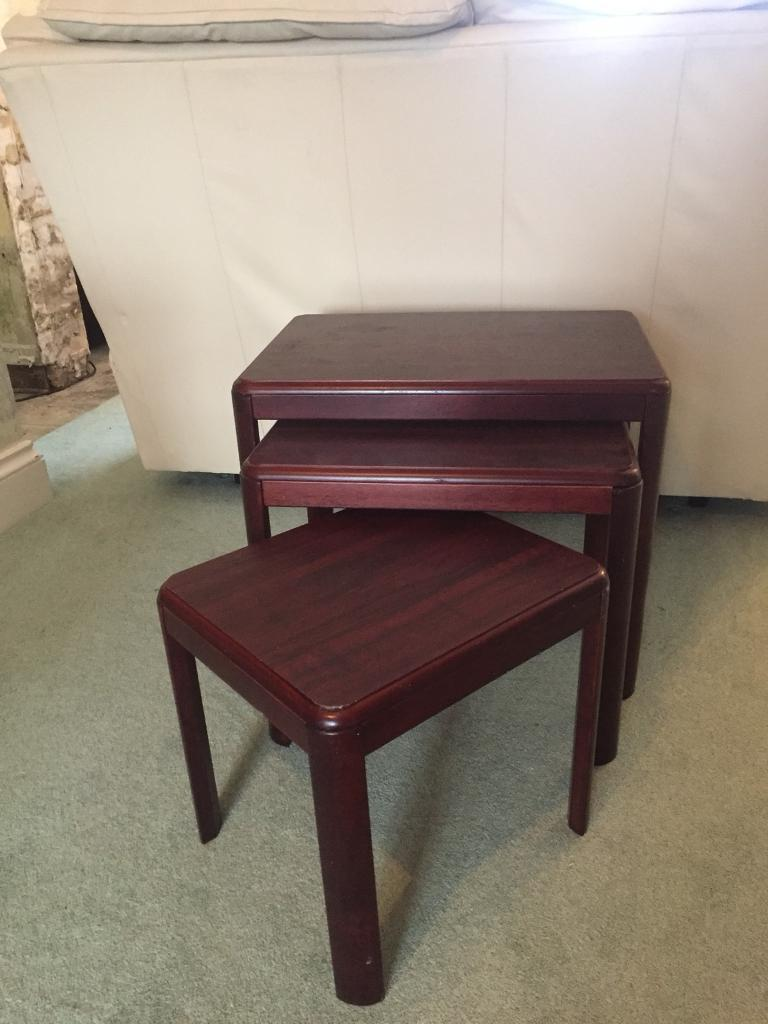 Nest of three small side tables brown