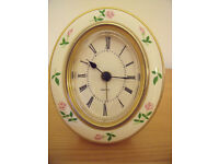 Vintage (1980s?) Marks & Spencer's (M&S) oval bedside alarm clock - rosebud ceramic effect surround.