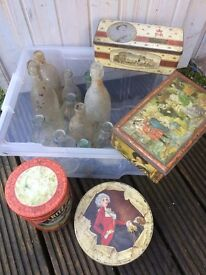A collection of old bottles and tins