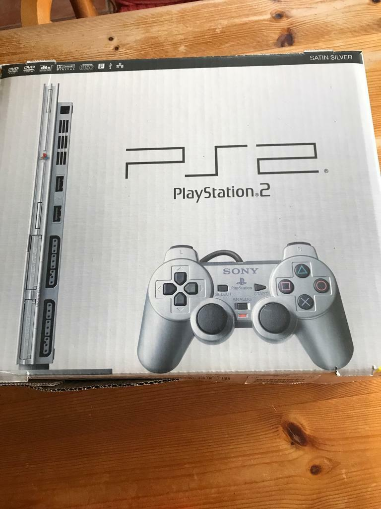 PlayStation 2 slim silver boxed plus more!
