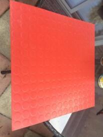 Red studded floor tiles