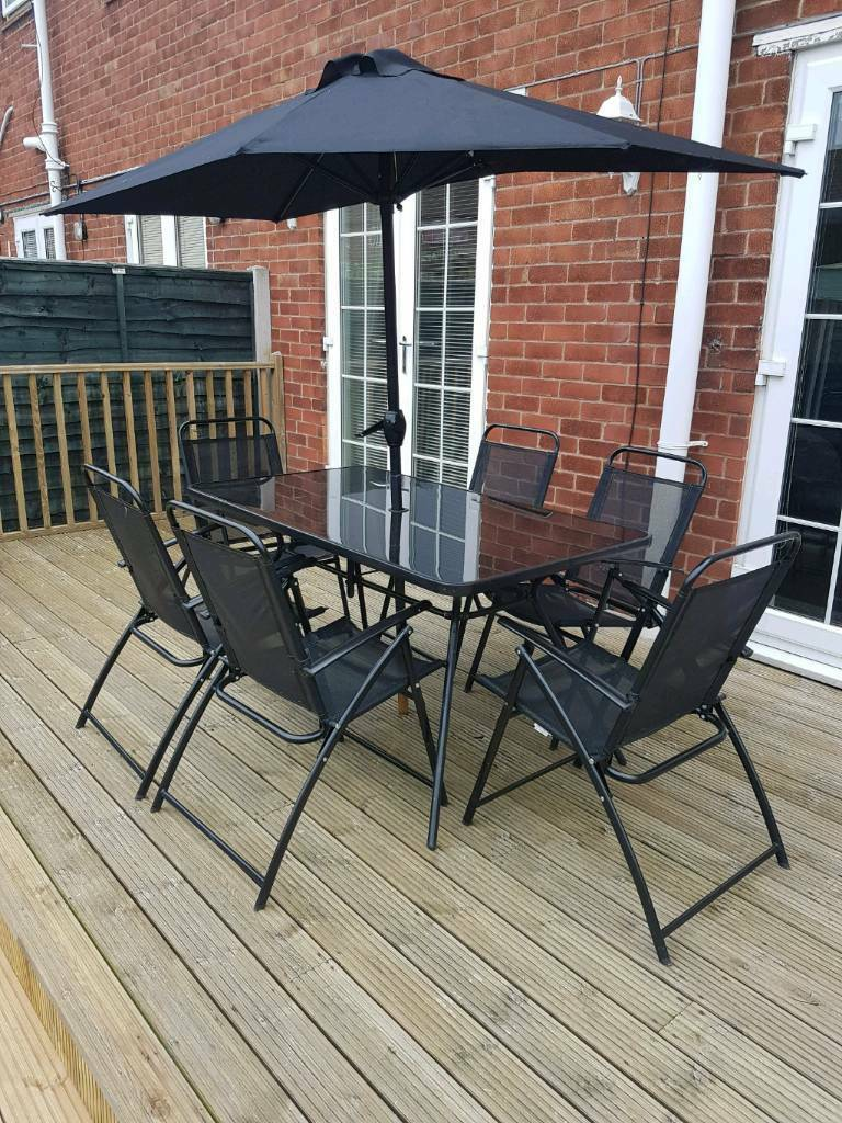 Black Rectangular Glass Patio Table And 6 Chairs In