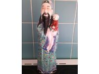 chinese emperor holding child