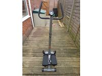 Stride Twist & Step exercise machine with handle