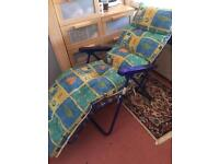 Foldable multi position sun lounger with cushion