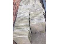 About 85 riven stone paving slabs