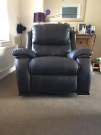 Brown leather rocking, spinning, reclining chair