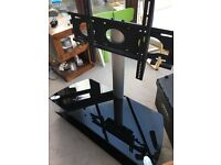 TV Stand- black glass. Great condition