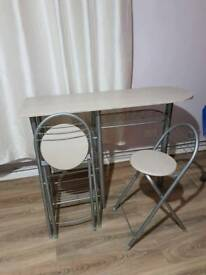 Table with 2 folding chair