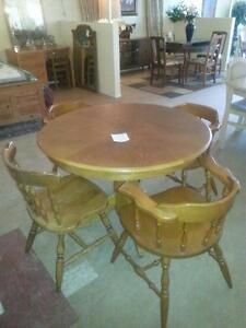 Round oak table and four chairs