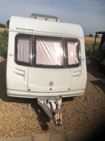 Fixed bed caravan with motor mover