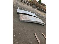 Curved galvanised sheets